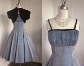 http://www.etsy.com/listing/118306943/1950-vintage-shimmery-blue-dress-with?ref=sr_gallery_11&ga_search_query=bolero&ga_view_type=gallery&ga_ship_to=ZZ&ga_page=6&ga_search_type=vintage
